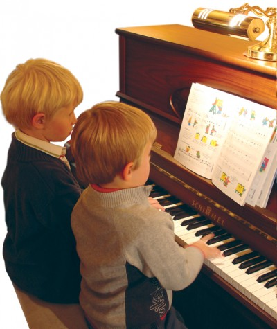 Youngsters learning piano