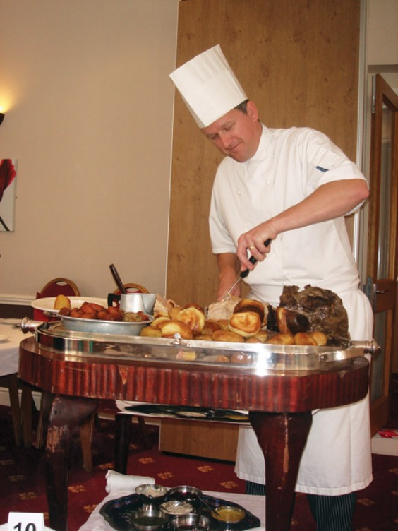 Owner and chef Andrew Hodges carves the meats