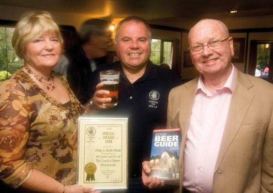 Sheila and Phil receive the award