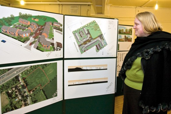 A resident inspects plans