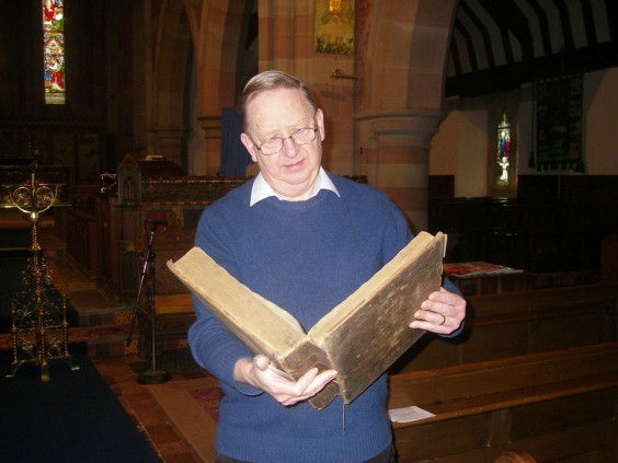 John hill reads from his family Bible