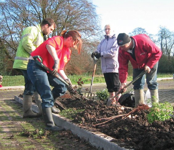 Volunteers lanscaping the car park