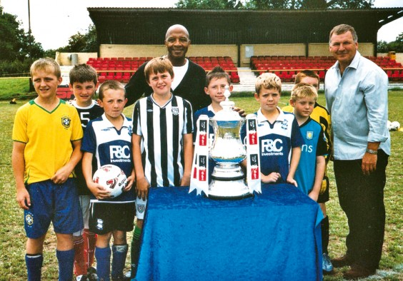 Young footballers with Cyrille Regis, Ray Stubbs and the FA Cup